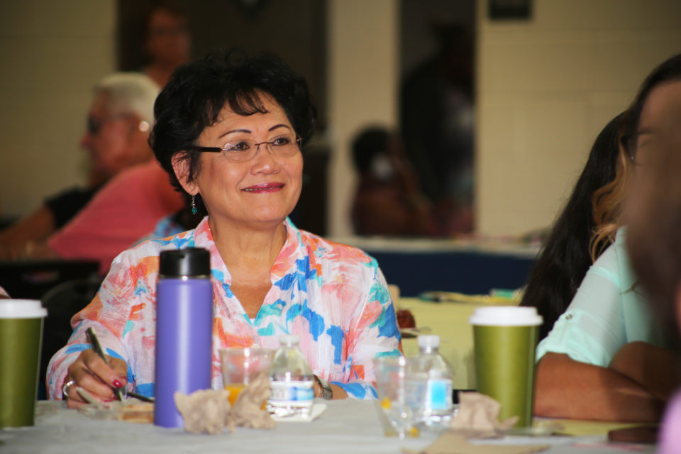 Isabela Cuerpo-Clark listened to a presentation on accessing medical information at the Interactive Technology and Health Fair for older adults at the George L. Stevens Senior Center.
