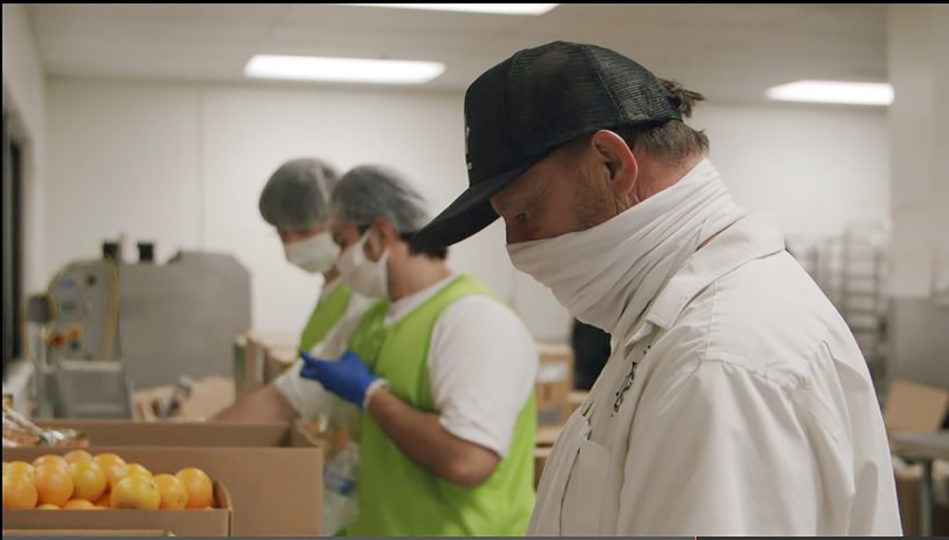 Sheriff's staff preparing meals for unsheltered.