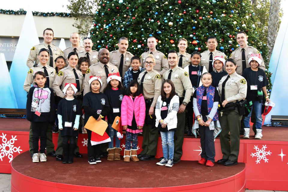 Deputies posed with their Shop With a Cop partners at the weekend event.