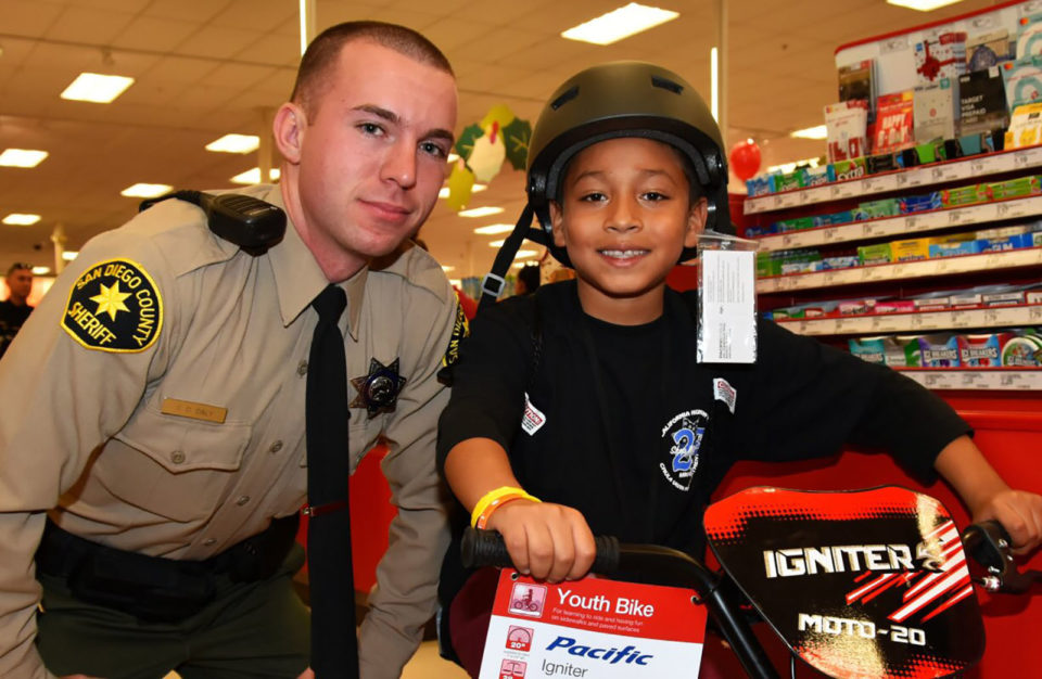 A Sheriff's deputy helped a boy select his new bicycle for the Shop With a Cop event.