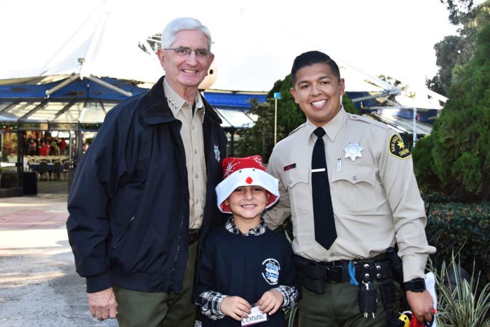 Sheriff Bill Gore stopped by Shop With a Cop to visit with the children.