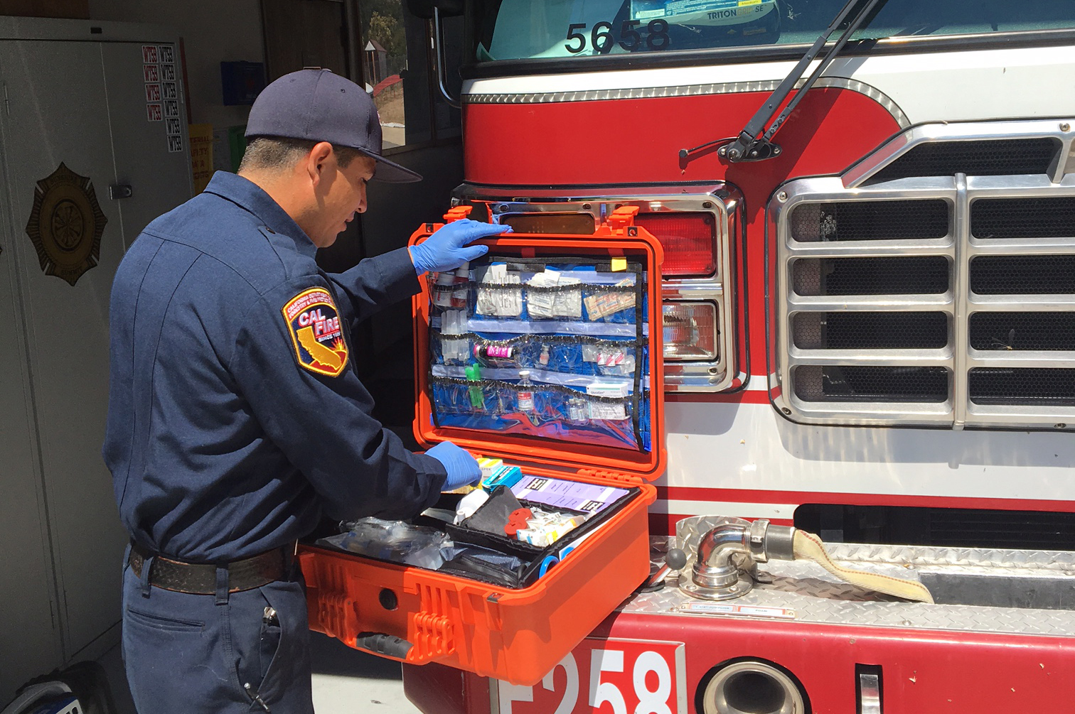 Firefighter Paramedic Ruben Vazquez of the Sunshine Summit County Fire Station takes inventory of his medications box.