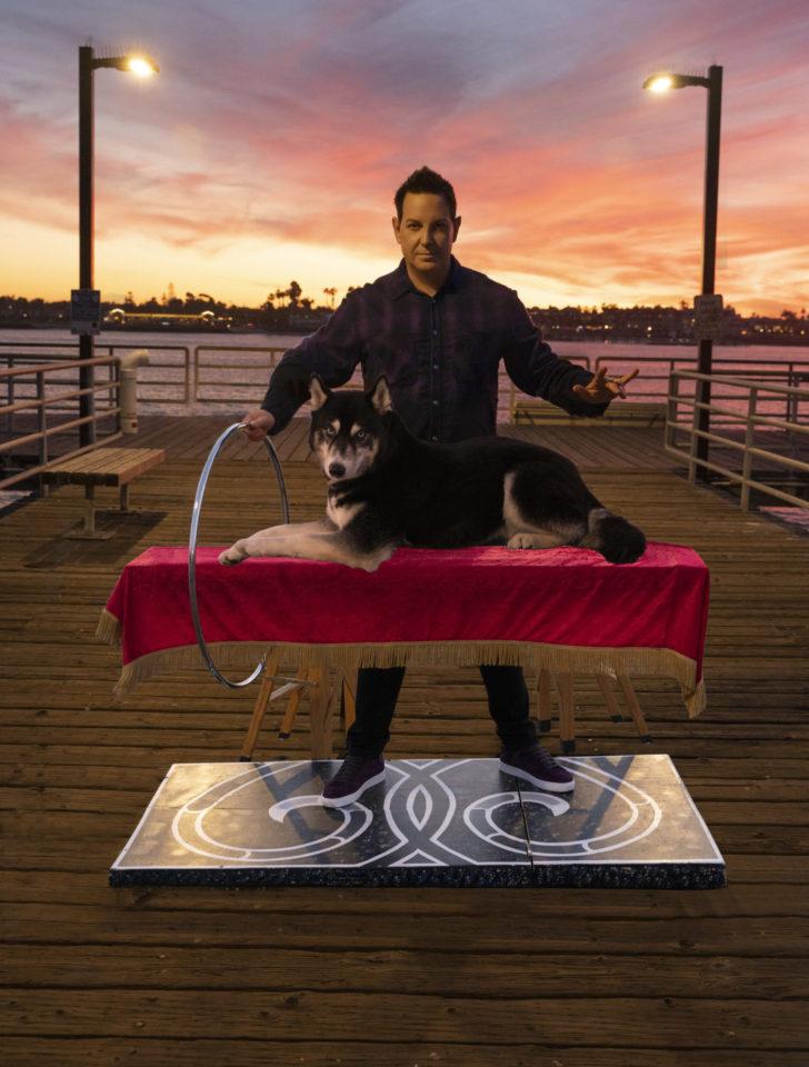 Magician levitating husky dog
