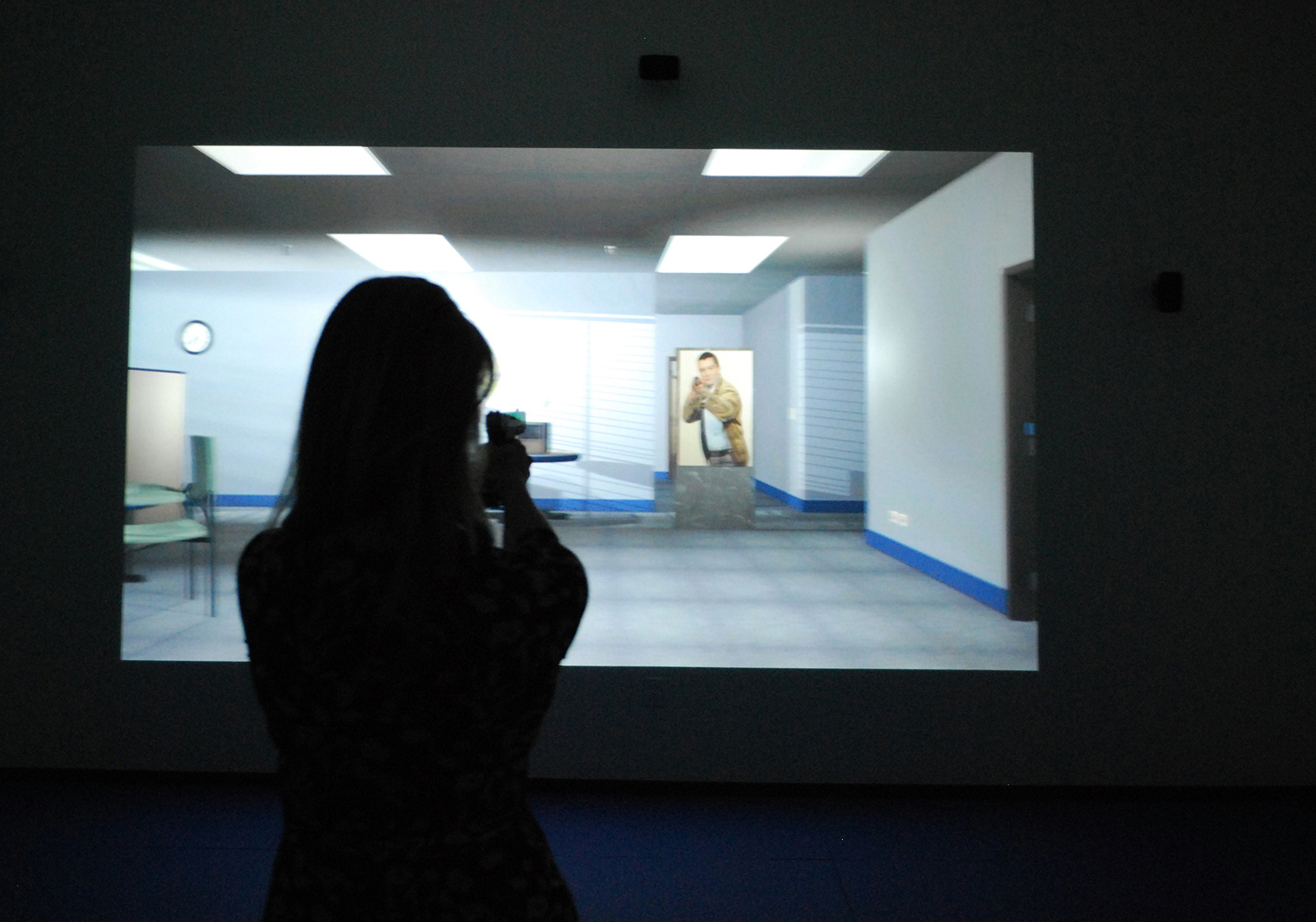 A guest tries out the use of force simulator at the Probation Training Center.