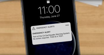 Photo of an iPhone with an Emergency Alert text.