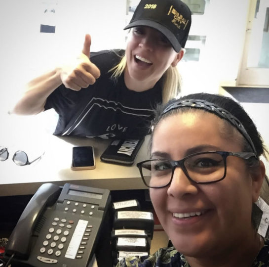 Department of Animal Services employee poses with Kaley Cuoco