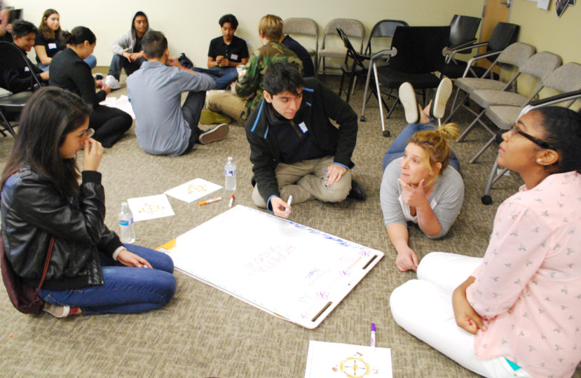 Youth Council teens, a new civic engagement organization, broke into groups with deputy public defenders to discuss the strengths of various leadership types, and to identify their own styles.