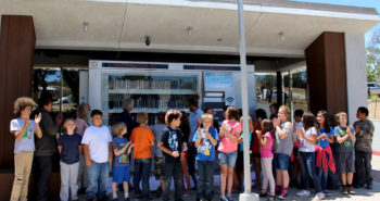 Clover Flat Elementary school students attend the opening of the new 24/7 library kiosk.