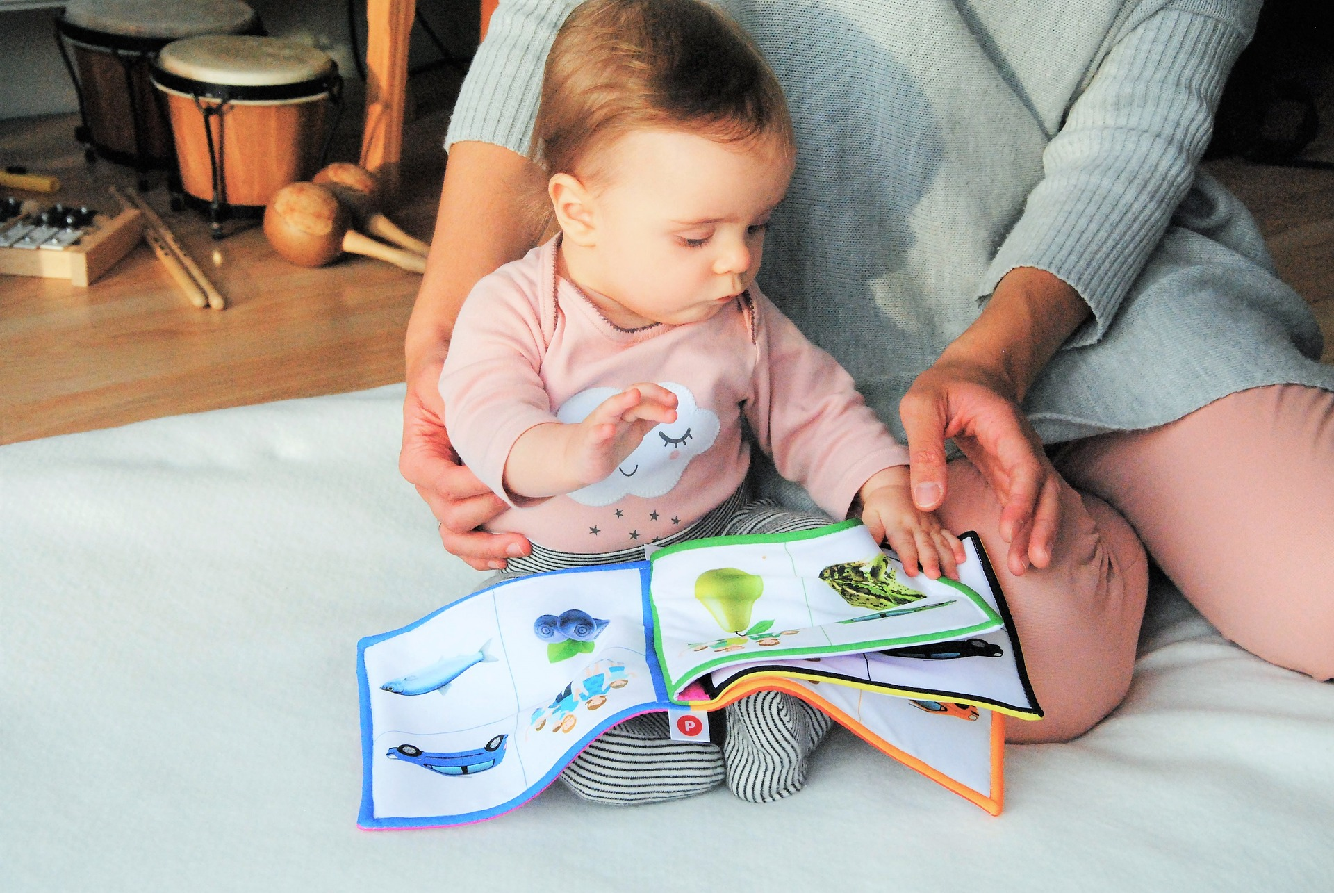 Baby engaging with book