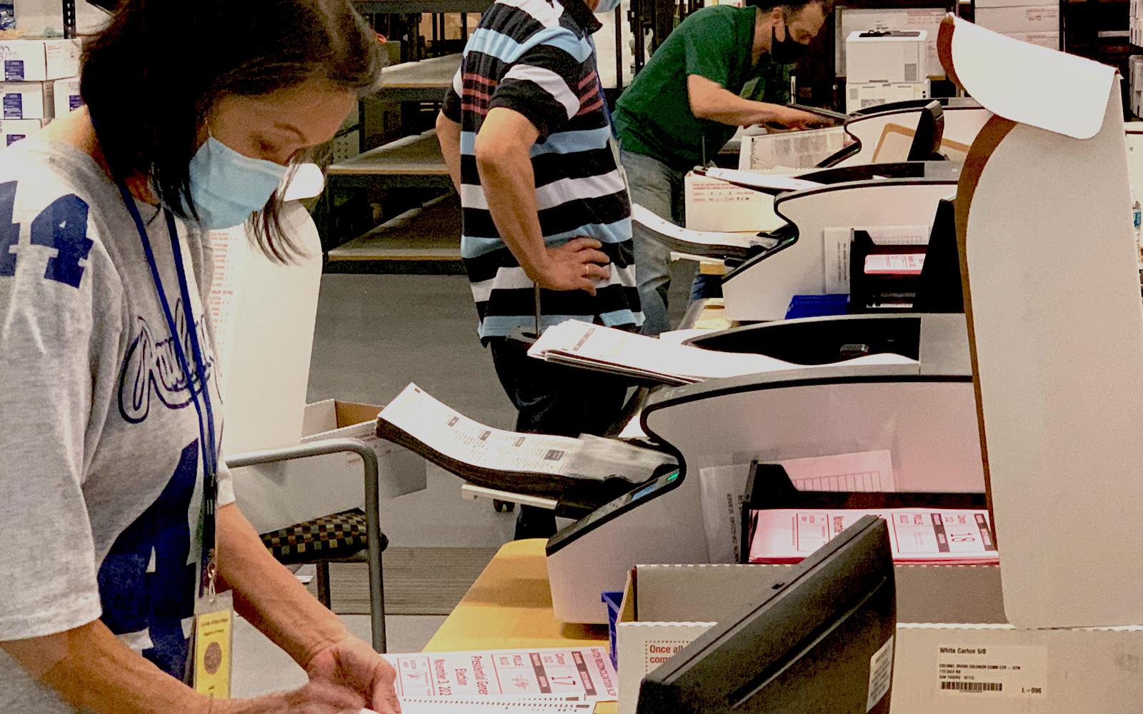 woman scanning ballots
