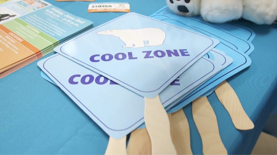 paper fan with Cool Zone logo