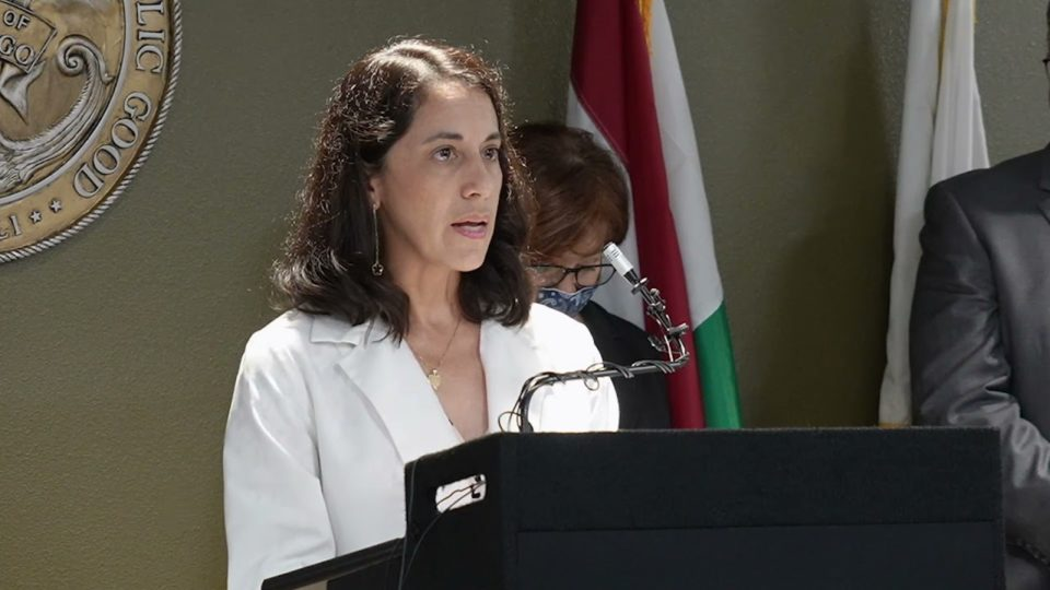 doctor speaks at a podium