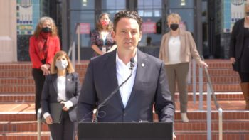 Chair Fletcher speaks at a podium in front of County Administration Center
