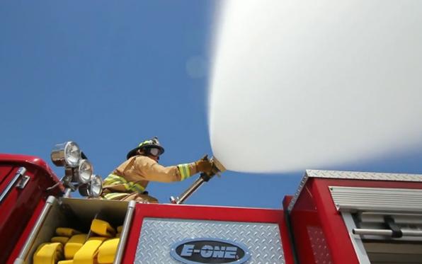 firefighter-ontruck-water