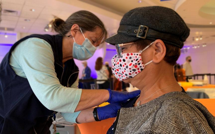 Person gets COVID-19 vaccine