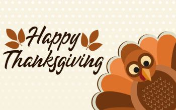 Graphic of cartoon turkey and Happy Thanksgiving