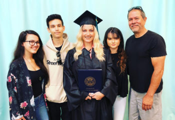 Gina Marie Hensel Carrey celebrates her graduation with her family.