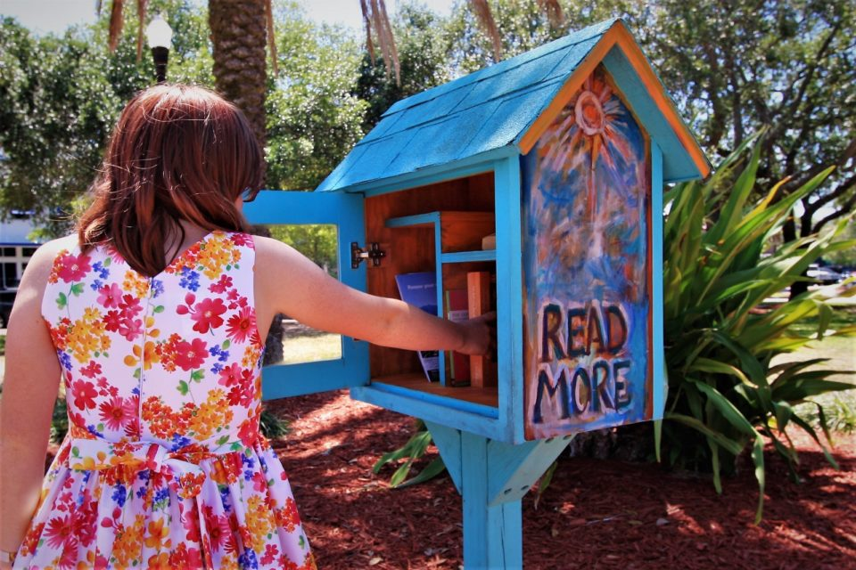 someone reached into a small painted Little Library