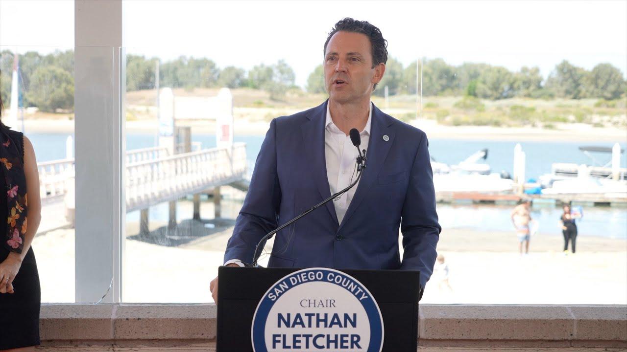 Chair Fletcher speaking at a podium