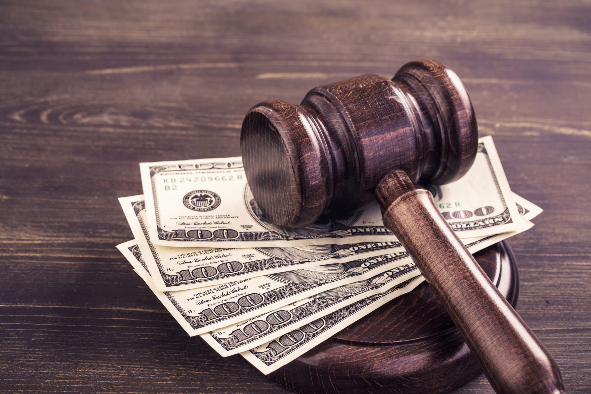 gavel and cash representing criminal fees.