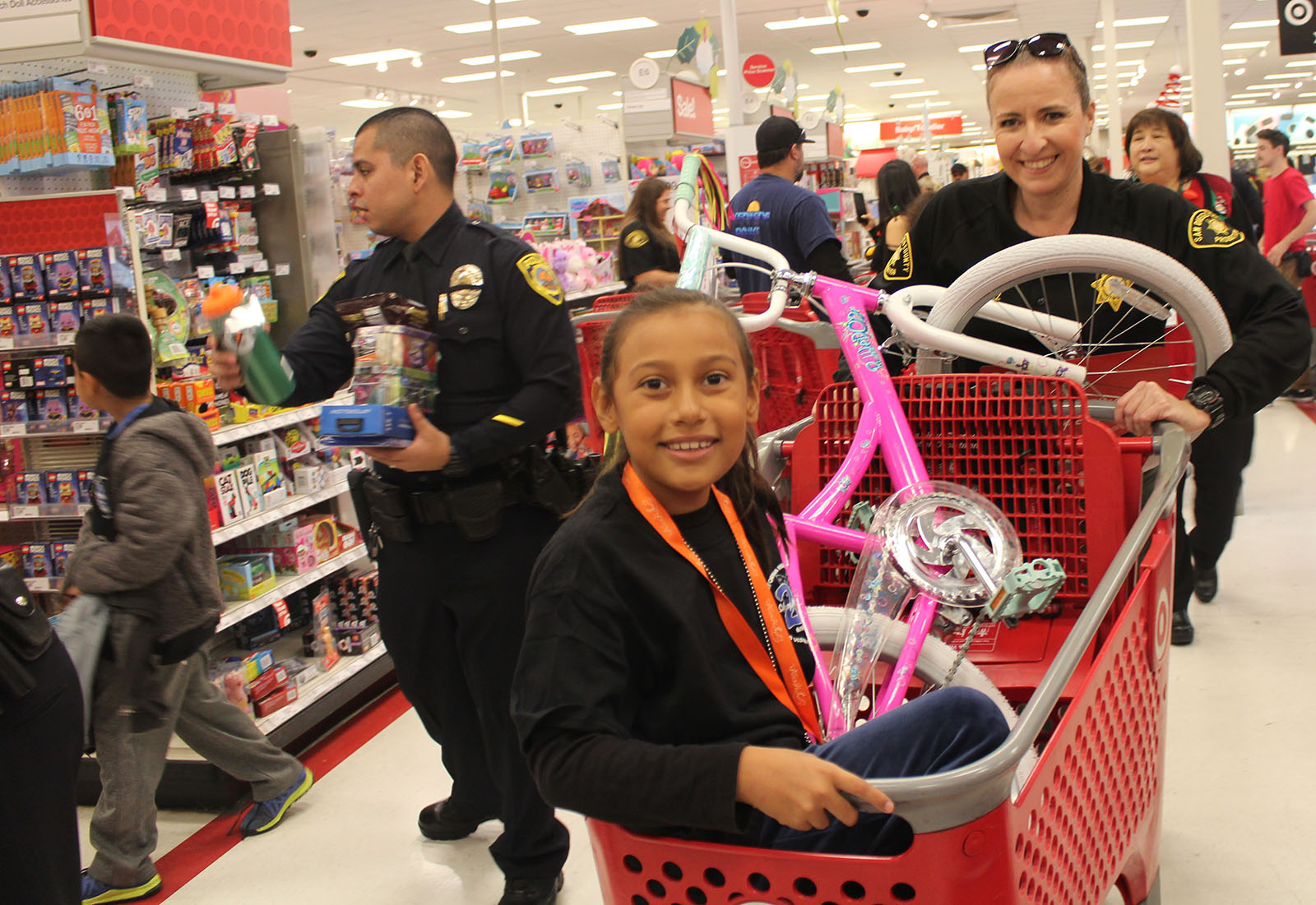 More than 300 children were treated to a shopping spree with local law enforcement.