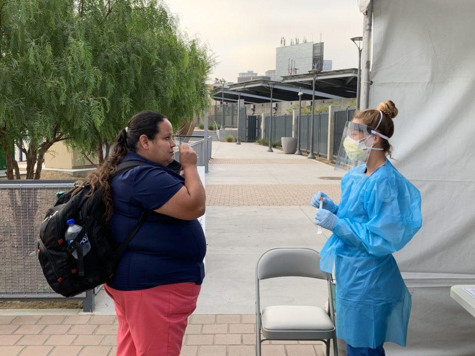 woman getting a COVID-19 test