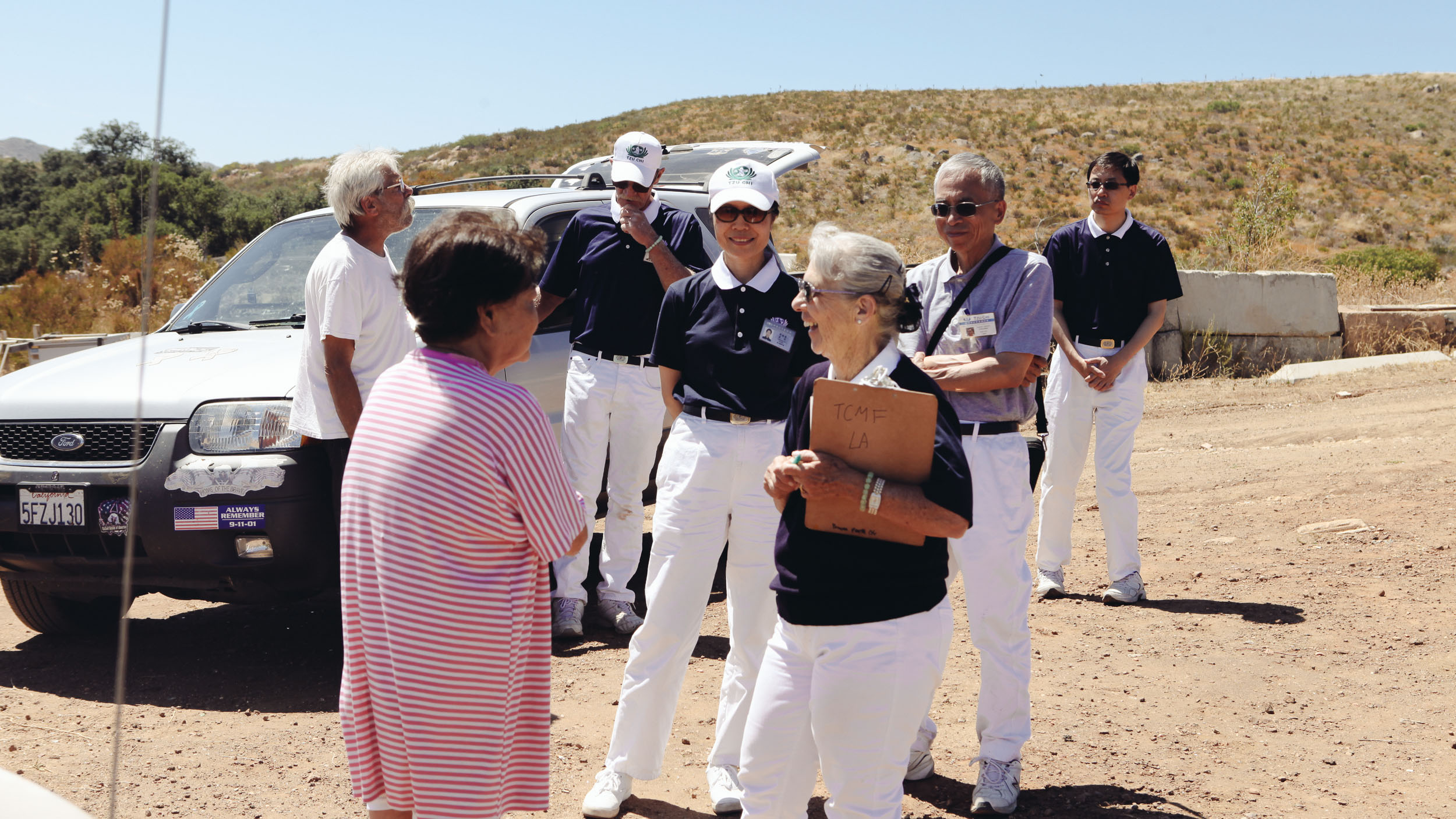 A Tzu Chi team check up on a woman who had been ordered to evacuate during the Border Fire.
